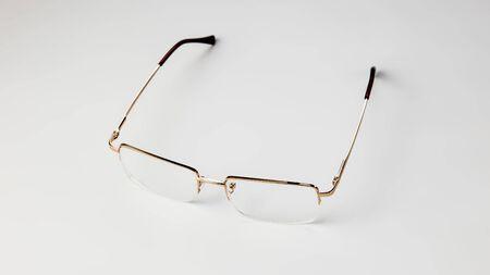 Gold eyeglasses on white background isolate
