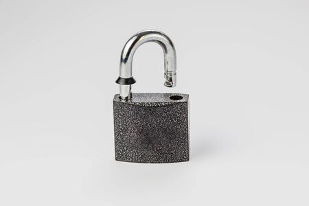 open lock on grey background isolate