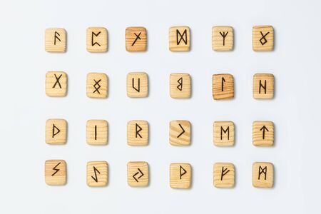 Wooden runes on white background isolate