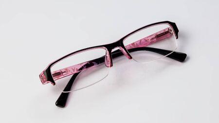 Glasses for vision on a light background. 免版税图像