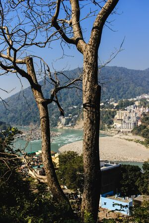 ancient yoga: View of Ganga and Rishikesh, holy Indian place, capital of yoga Stock Photo
