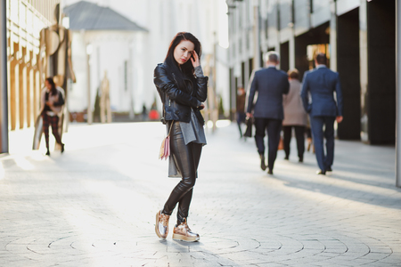 beautifull woman: street portrait of young beautifull woman with long black hair, thinking about somebody Stock Photo
