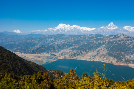 phewa: Famous tourist view of Phewa lake and Annapurna mountain  range from World Peace Pagoda in Pokhara, Nepal Stock Photo