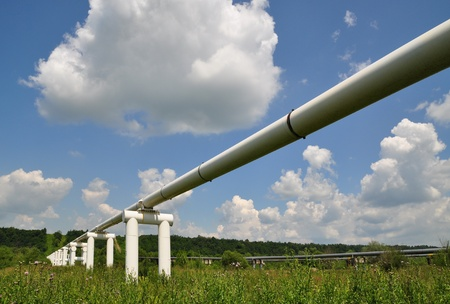 The main oil pipeline of a high pressure in a summer landscape under clouds. Stock Photo - 8483516
