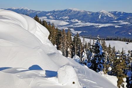 snowdrifts: Snowdrifts in a mountain landscape.