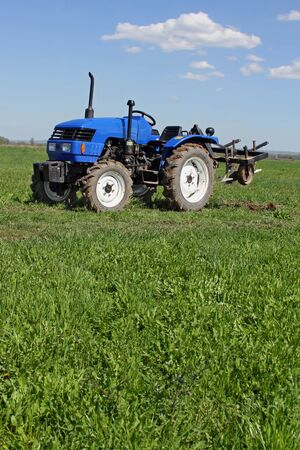 agricultural application tractor: Tractor on a spring field