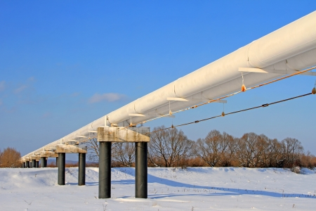 The high pressure pipeline in a winter landscape photo