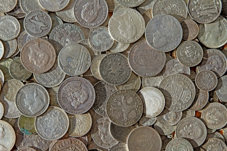 florin: Ancient silver coins in a background photo