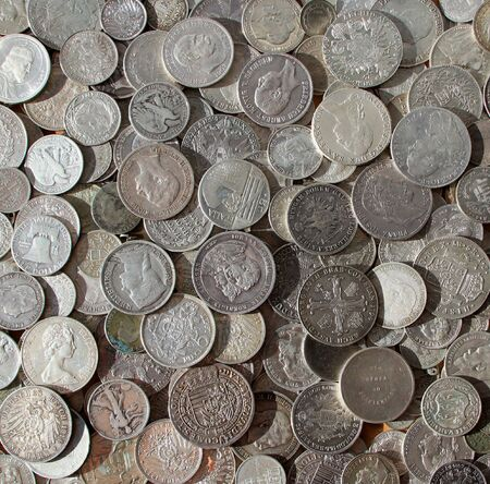 florin: Ancient silver coins in a background
