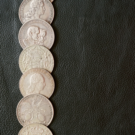 florin: Ancient silver coins on a leather surface