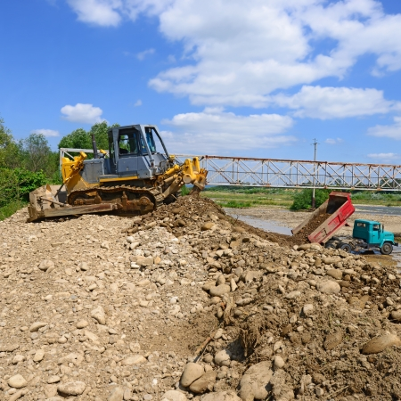 Work to strengthen the shoreline of the river photo
