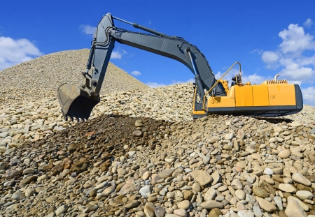 Loading gravel excavator photo