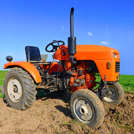 farm implement: Wheeled tractor in the field
