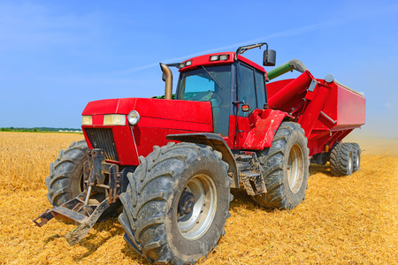 Tractor with a tank for transporting grain Stock Photo - 23217771