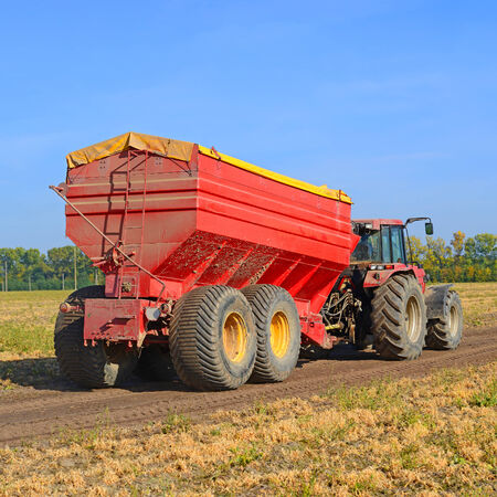 agricultural tenure: Tractor with a tank for transporting grain