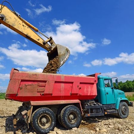 Extracting and loading gravel excavated  photo