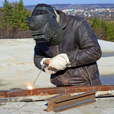 Welder working on a construction site  Stock Photo