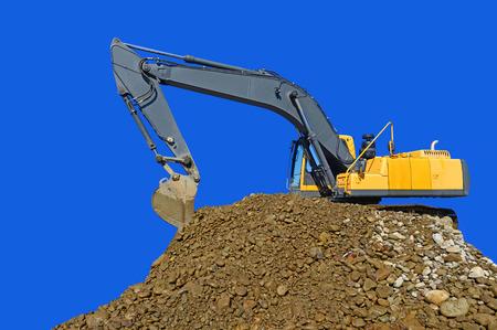 Loading gravel excavator Standard-Bild