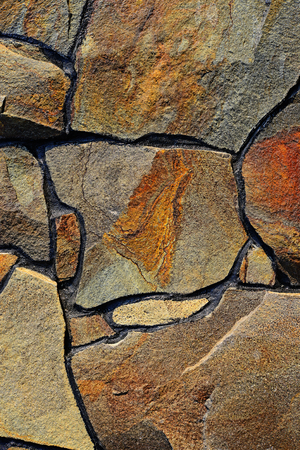 Fragment of a wall from a chipped stone   photo