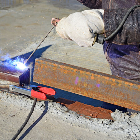 consumable: Welder working on a construction site  Stock Photo