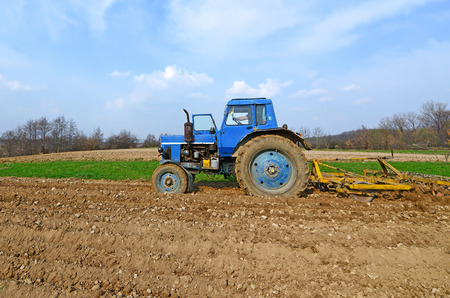 agricultural application tractor: Fallowing of a spring field  Stock Photo