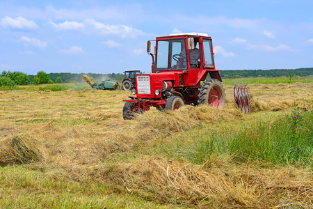agricultural application tractor: Hay harvesting Stock Photo