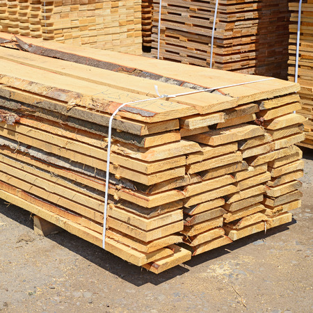 primary product: Eaves board in stacks Stock Photo