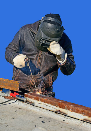 Welder working on a construction site. photo