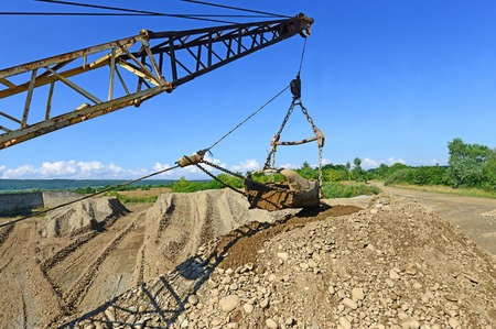 open cast mine: Extraction of gravel by a dredge in open cast