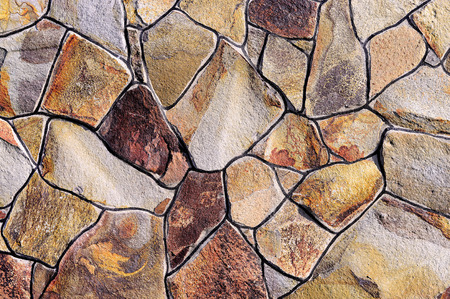 capping: Fragment of a wall from a chipped stone