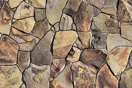 facing a wall: Fragment of a wall from a chipped stone
