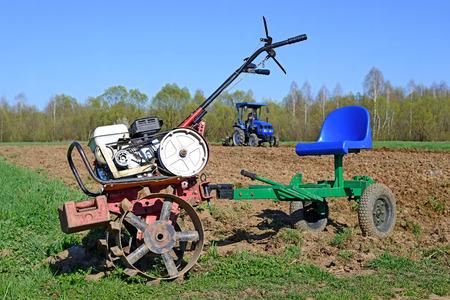 Mechanized plow on a spring field photo
