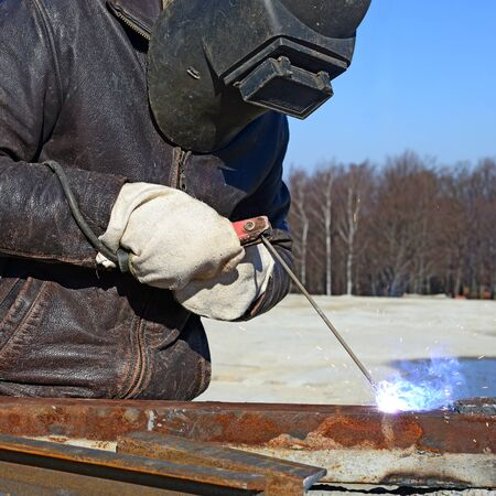 consumable: Welder working on a construction site. Stock Photo