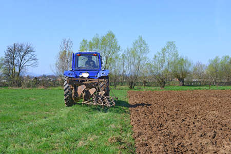 rural economy: Farmer on tractor handles field