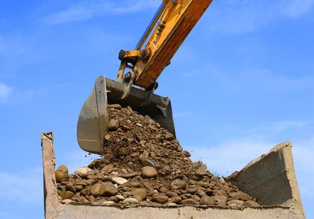 gravel pit: Loading gravel in the car body Stock Photo