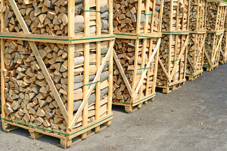 log deck: Chipped fire wood in packing on pallets Stock Photo