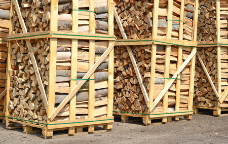 forest products: Chipped fire wood in packing on pallets Stock Photo