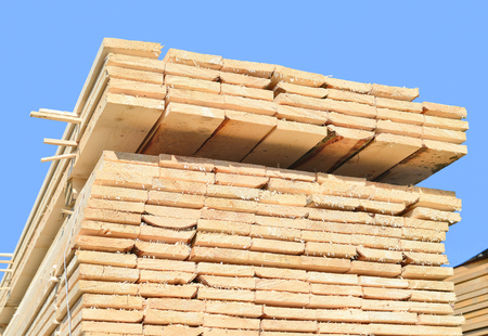 forest products: Eaves board in stacks Stock Photo