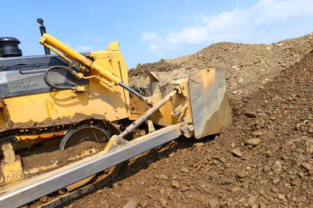 dump yard: The bulldozer on a building site