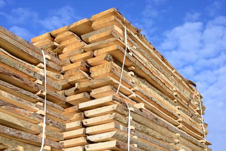 log deck: Edging board in stacks