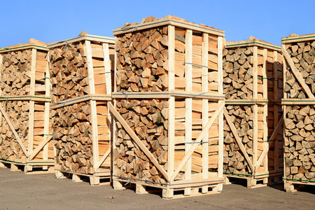 depository: Chipped fire wood in packing on pallets Stock Photo