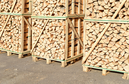 fire wood: Chipped fire wood in packing on pallets Stock Photo
