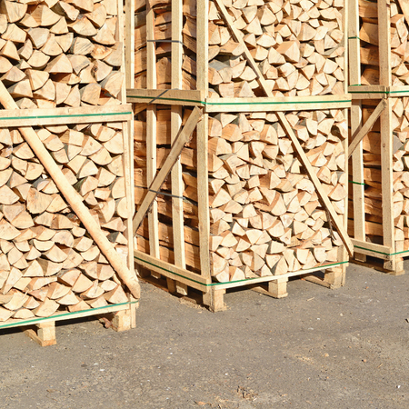 bolster: Chipped fire wood in packing on pallets Stock Photo
