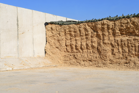 Storage silos in a trench silo