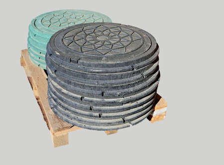 runoff: Sewer manholes with a lid on the pallet Stock Photo