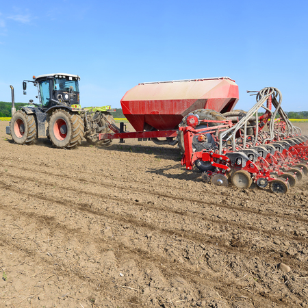 farm implements: Planting corn trailed planter in the field