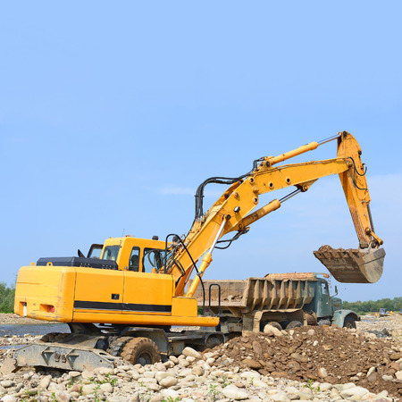 Extracting and loading gravel excavated in the mainstream of the river Stock Photo