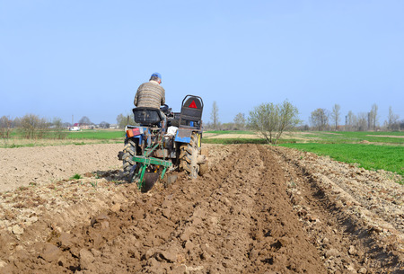 hauling tractor: Farmer on tractor handles field