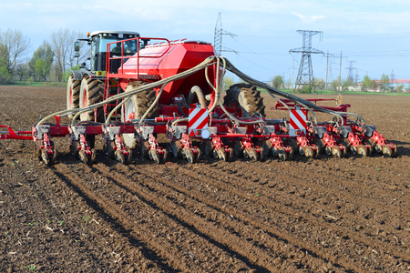 hauling tractor: Planting corn trailed planter