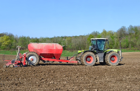 farm implements: Planting corn trailed planter
